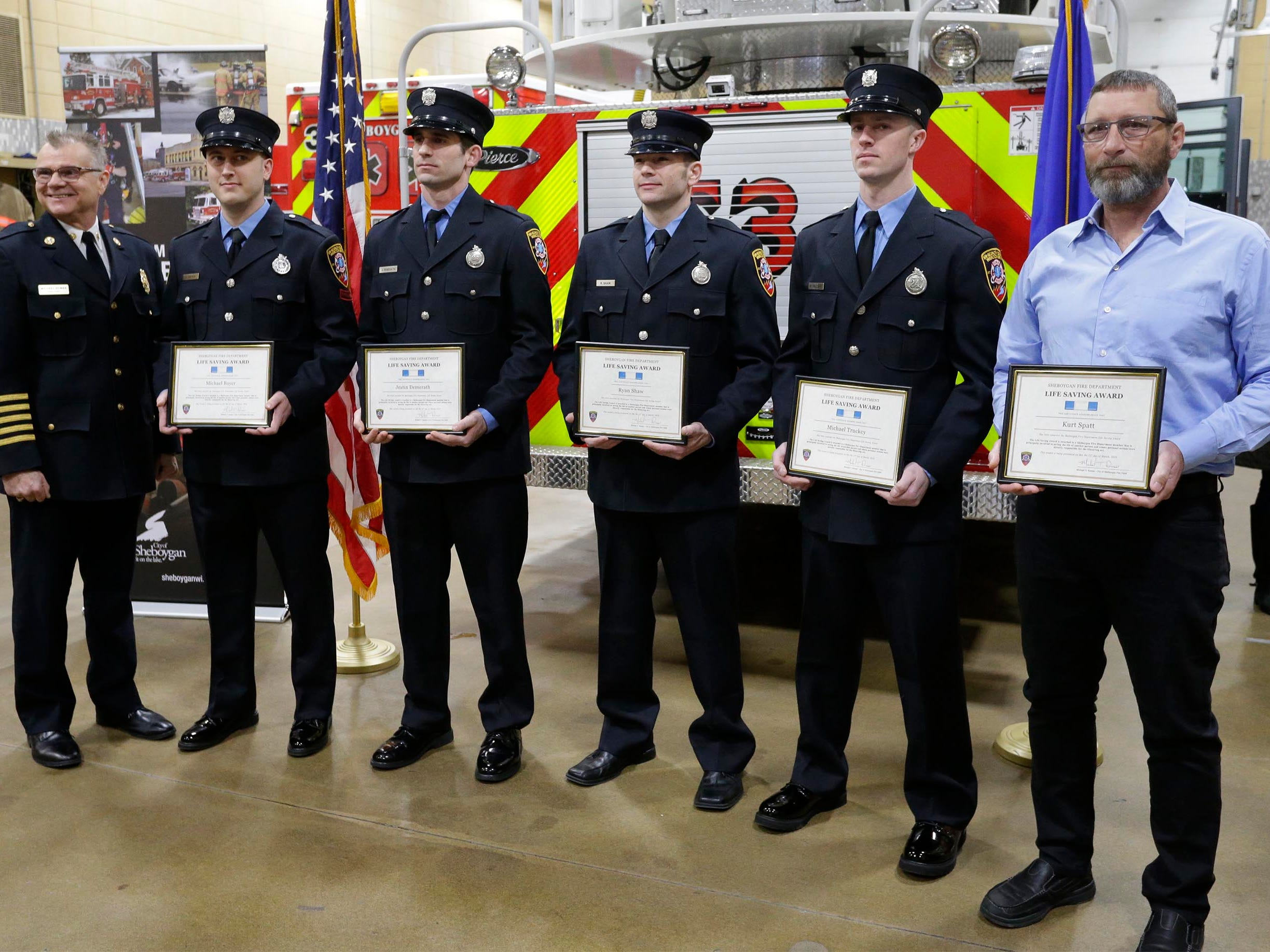 Sheboygan Fire Chief Mike Romas poses with the five honored firefighters, Wednesday, February 21, 2019, in Sheboygan, Wis. The honored firefighters from left are: Michael Bayer, Justin Demerath, Ryan Shaw, Michael Truckey and Kurt Spatt.