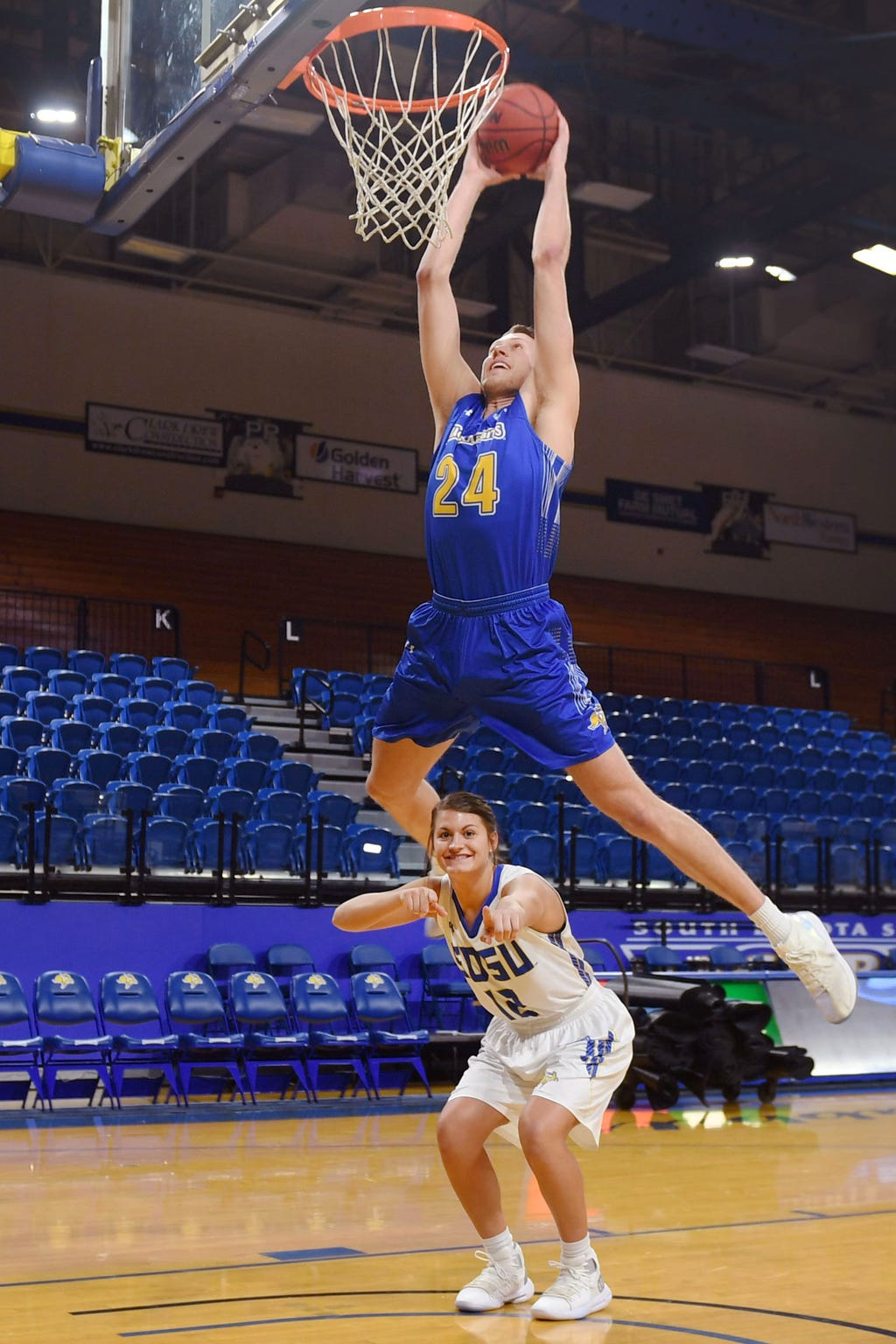 SDSU's Mike Daum dunks over Macy Miller Tuesday, Feb. 19, in Brookings.