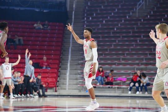 South Dakota guard Stnaley Umude celebrates a 3-pointer against Denver on Wednesday, Feb. 20, 2019.
