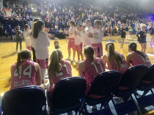 SDSU starters prepare for pregame introductions Wednesday at Frost Arena