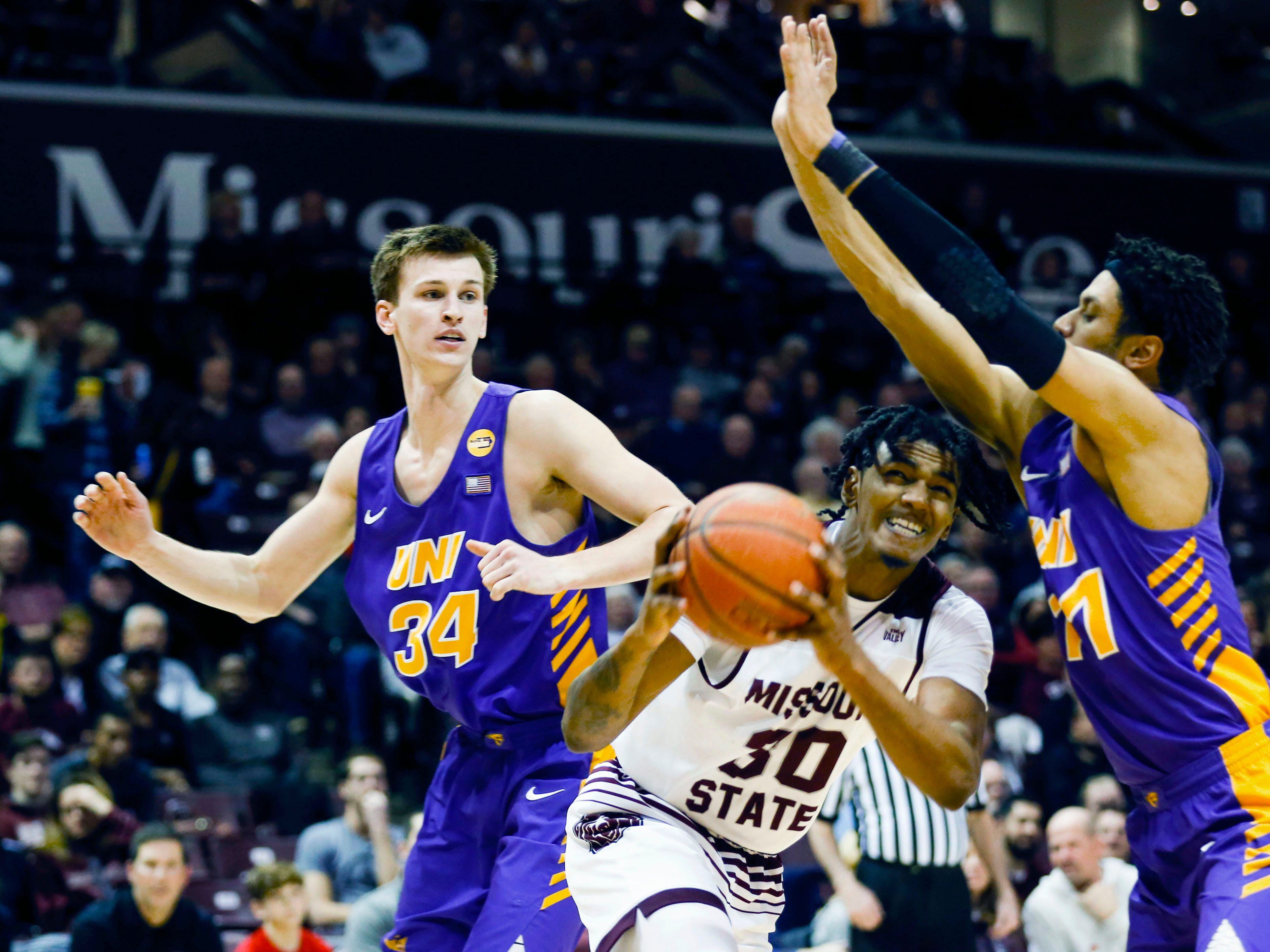 Missouri State's Tulio Da Silva drives around UNI's Trae Berhow (right) and Luke McDonnell on his way to the basket as the Bears take on the Panthers at JQH Arena on Wednesday, Feb. 20, 2019.