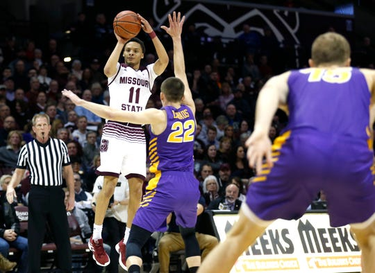 Missouri State's Jarred Dixon shoots a field goal over UNI's Wyatt Lohaus as the Bears take on the Panthers at JQH Arena on Wednesday, Feb. 20, 2019.