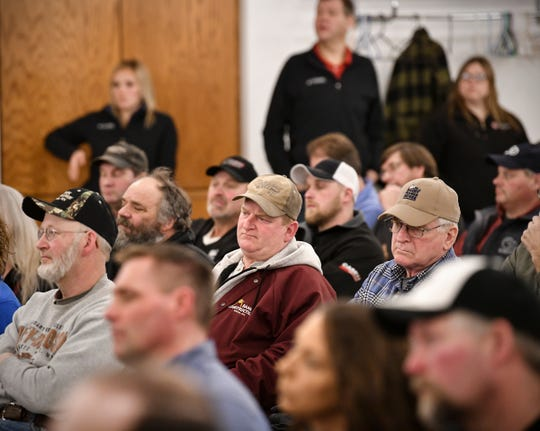 Audience members listen as Minnesota Congressmen Collin Peterson and Tom Emmer speak during a town hall meeting Thursday, Feb. 21, in Melrose.