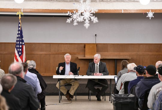 Minnesota Congressmen Collin Peterson and Tom Emmer talk about the recently-passed federal farm bill during a town hall meeting Thursday, Feb. 21, in Melrose.