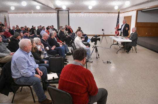 People listen as Minnesota Congressmen Collin Peterson and Tom Emmer speak during a joint town hall meeting Thursday, Feb. 21, in Melrose.
