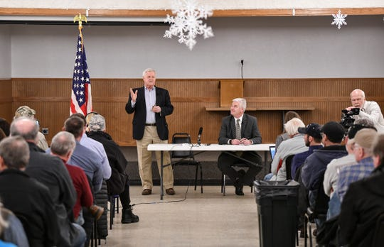 Minnesota Congressmen Collin Peterson and Tom Emmer speak during a town hall meeting Thursday, Feb. 21, in Melrose.