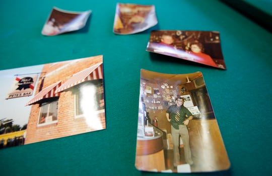 Photos of previous establishment owners are displayed on a pool table on Feb. 15 at Jacks  in Marshfield.