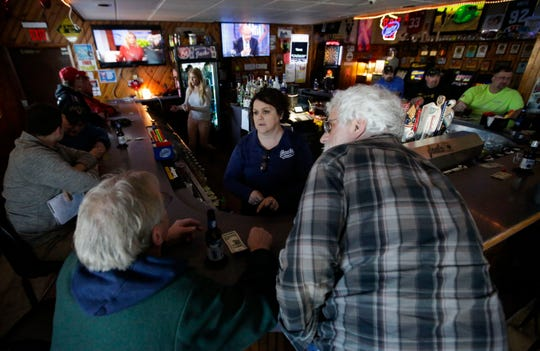 Tammy Miller, owner of Jacks bar in Marshfield, talks with patrons on Feb. 15.