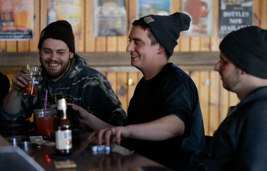 Bradey Duett, left, and Marc Smazal share a laugh on Feb. 15 at Jack's Bar in Marshfield.