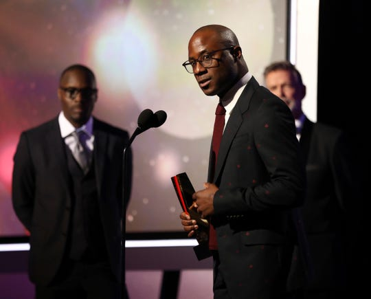 """Barry Jenkins accepts the award for best time capsule movie for """"If Beale Street Could Talk"""" at AARP The Magazine's 18th Annual Movies For Grownups Awards at Beverly Wilshire Hotel on Monday, Feb. 4, 2019, in Beverly Hills, Calif."""