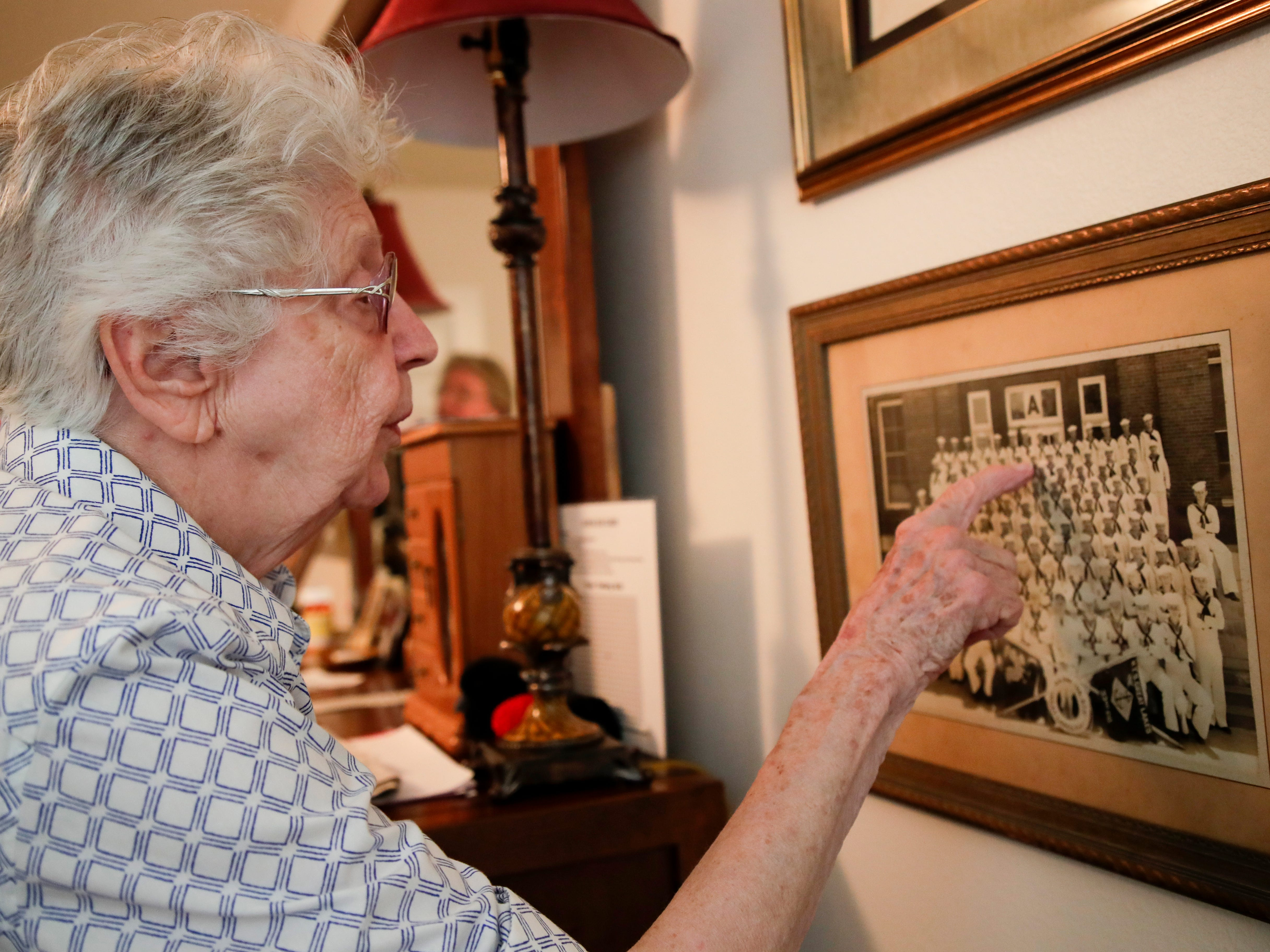 Emily Golz, 92, points to her brother Earl Baum in his naval academy graduating class photo that hangs in her bedroom nearly 78 years after he died at Pearl Harbor Dec. 7, 1941.
