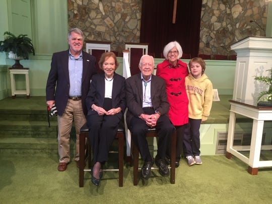 Candace McKibben, Bruce and grandson Rowen with President Jimmy Carter and Rosalynn at Maranatha Baptist Church , Plains, Georgia. Photos like this one are a common sight in Tallahassee Facebook feeds from those who make the Plains pilgrimage to see the nation's 49th president.