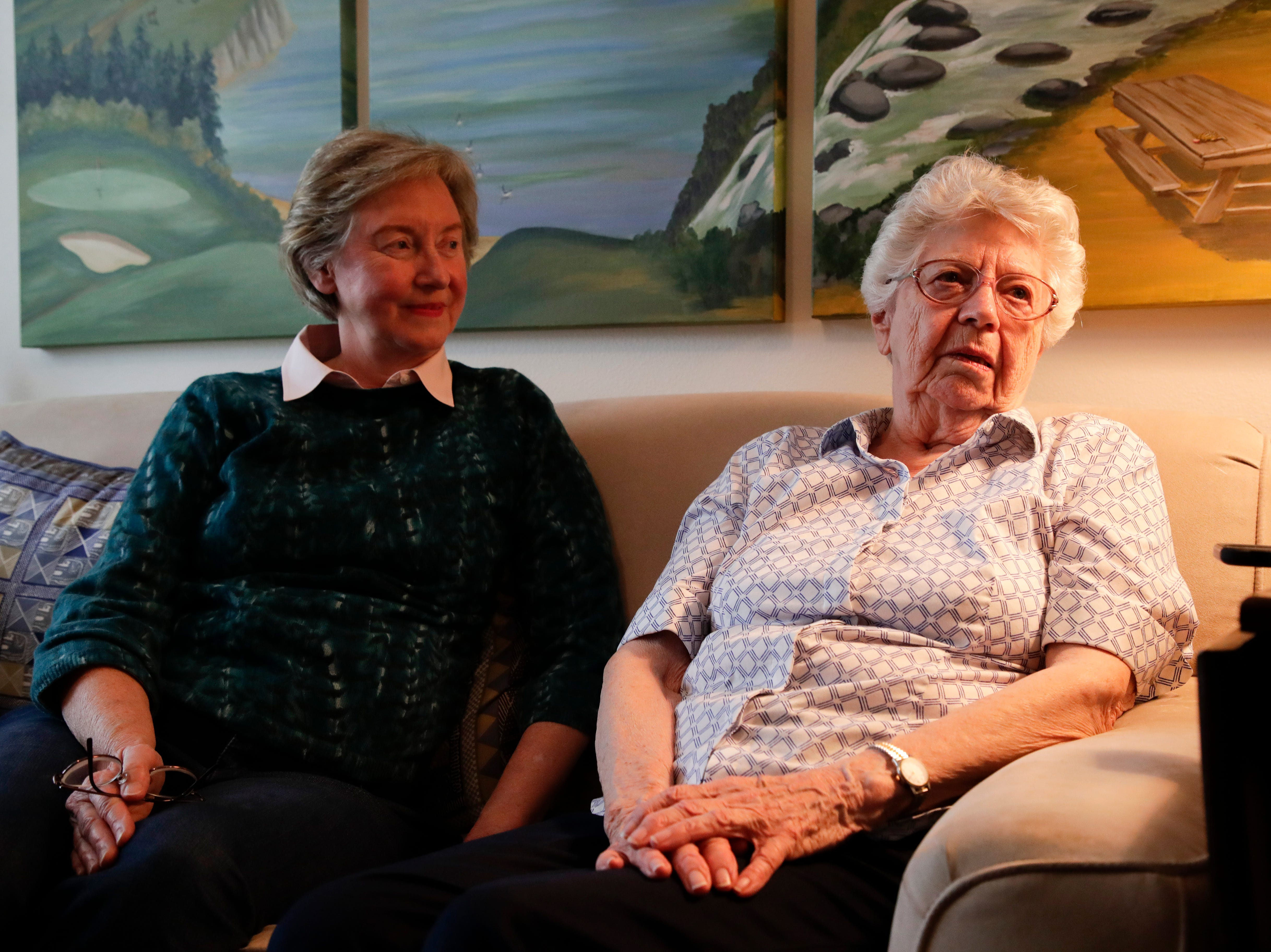 Emily Golz, right, 92, and her daughter Sandy DeLopez sit in the living room of Golz's apartment talking about Golz's brother Earl Baum who died at Pearl Harbor Dec. 7, 1941. Baum's remains were identified last year through DNA. He will be buried March 8, 2019 at Tallahassee National Cemetery.