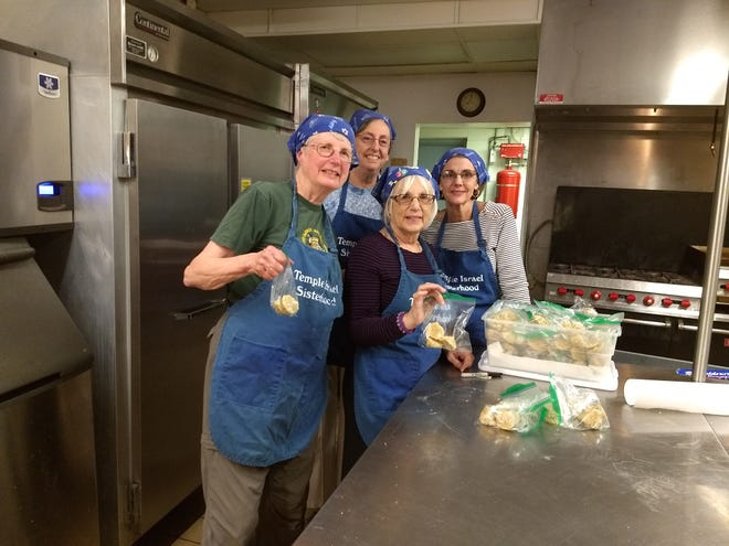 The baking group at Temple Israel making macaroons for the Jewish Food Festival features Chris Grossman, Lala Clark, Michelle Sonnenfeld, Brenda Vaughn.