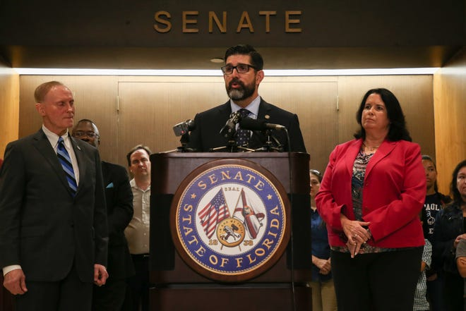 Sen. Manny Diaz Jr. takes questions from the press after he, Senate President Pro Temper David Simmons and Sen. Kelli Stargel announced education legislation that will come up in legislative session in front of the Senate chamber Thursday, Feb. 21, 2019.