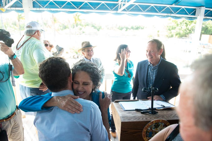Jacqui Thurlow-Lippisch, of Sewall's Point, a longtime advocate for the St. Lucie River and Indian River Lagoon, embraces Michael Meier, a Stuart city commissioner, after Thurlow-Lippisch was appointed to the South Florida Water Management District board by Gov. Ron DeSantis on Thursday, Feb. 21, 2019, at the Florida Oceanographic Coastal Center in Stuart. U.S. Rep. Brian Mast, Secretary of the Florida Department of Environmental Protection Noah Valenstein and several local dignitaries and environmental advocates were in attendance.