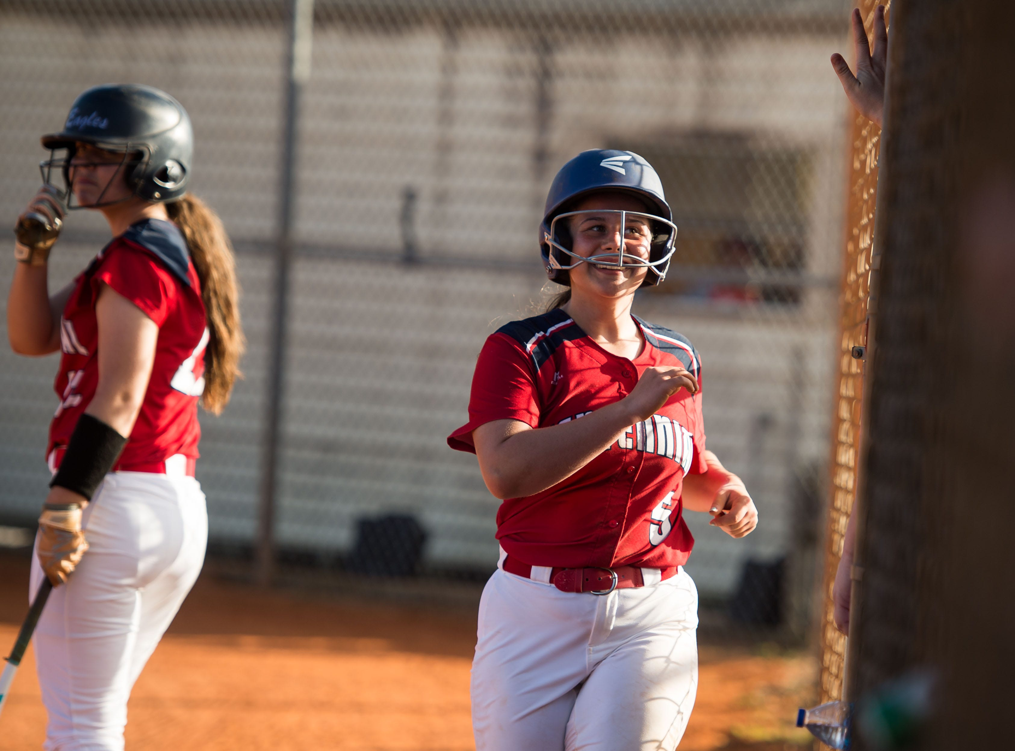 St. Lucie West Centennial's Jayden Sullivan runs back to the dugout triumphantly after stealing home to score in the second inning against Port St. Lucie during the high school softball game Wednesday, Feb. 20, 2019, at St. Lucie West Centennial High School in Port St. Lucie.