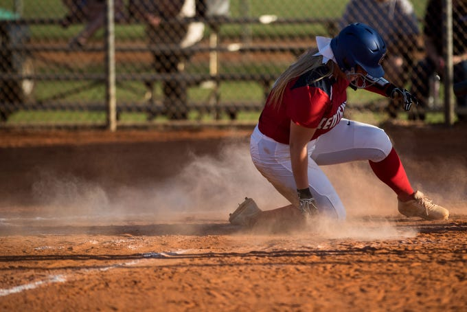 St. Lucie West Centennial's Cassidee Russo steals home, bringing the score to 13-1, in the bottom of the fourth inning against Port St. Lucie during the high school softball game Wednesday, Feb. 20, 2019, at St. Lucie West Centennial High School in Port St. Lucie.