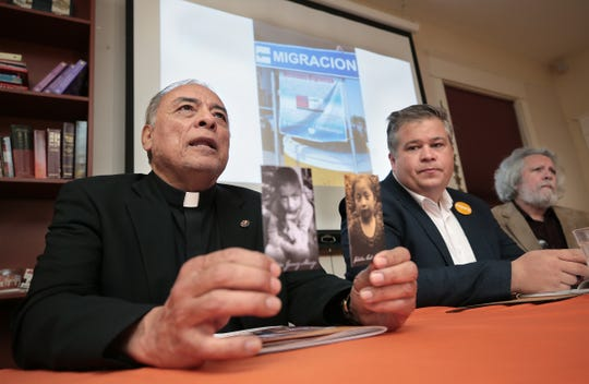 Msgr. Arturo Banuelas holds photos of Felipe Gomez-Alonzo and Jakelin Caal Maquin, two children who have died in Border Patrol custody. A group from Hope Border Institute traveled to Guatemala in a show of solidarity with the families of the deceased migrants.