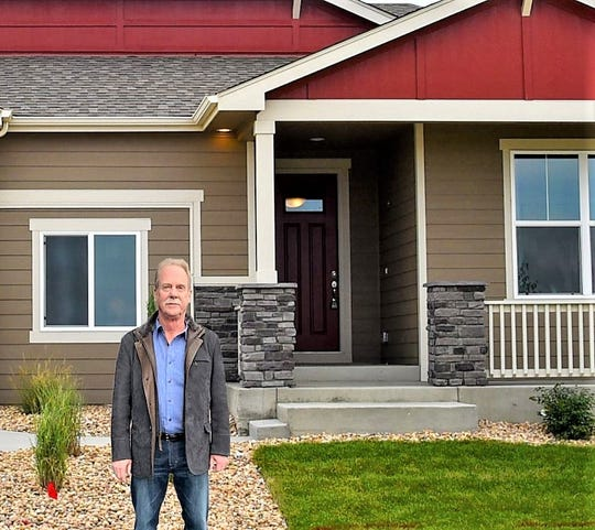 Randy O'Leary, CEO and owner of View Homes, stands outside a Horizon View model home in Windsor, Colo.