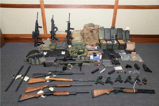 """This photo provided by the U.S. District Court in Maryland shows firearms and ammunition. It was in the motion for detention pending trial in the case against Christopher Paul Hasson. Prosecutors say that Hasson, a Coast Guard lieutenant, is a """"domestic terrorist"""" who wrote about biological attacks and had a hit list that included prominent Democrats and media figures. He is due in court Thursday, Feb. 21, 2019, in Maryland. Prosecutors say Hasson espoused extremist views for years. Court papers say Hasson described an """"interesting idea"""" in a 2017 draft email that included """"biological attacks followed by attack on food supply."""""""