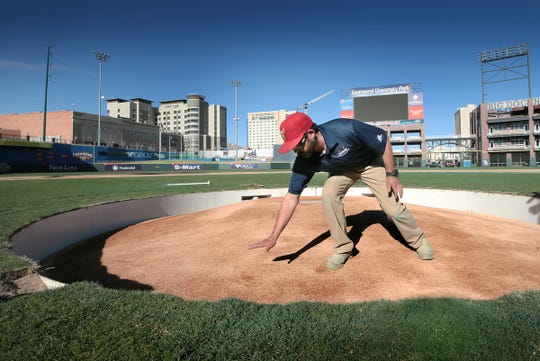 Southwest University Park Grounds Manager Travis Howard demonstrates the new retractable pitching mound. The mound will have to retract to covert the field from a baseball diamond to a soccer field. The mound takes just under 10 minutes to fully retract and is then covered  for soccer play.