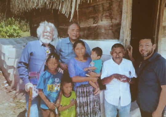 A photograph of the group from Hope Border Institute with the family of Jakelin Caal Maquin in Guatemala.