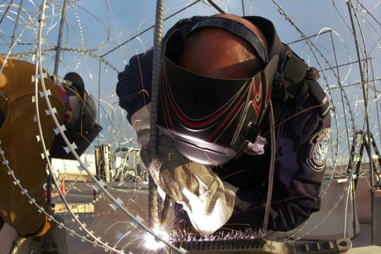 U.S. Customs and Border Protection is adding concertina wire and concrete K-rails at ports of entry in the El Paso area to prevent immigrants from surging into the U.S., officials said.