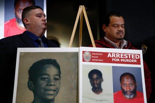 Hubert Tillett, right, brother of William Tillett, stands behind a display showing his brother, bottom left, during a news conference Wednesday in Inglewood. Authorities say a 50-year-old man is in custody in connection with the kidnapping and killing of then 11-year-old William Tillett in Southern California nearly three decades ago.