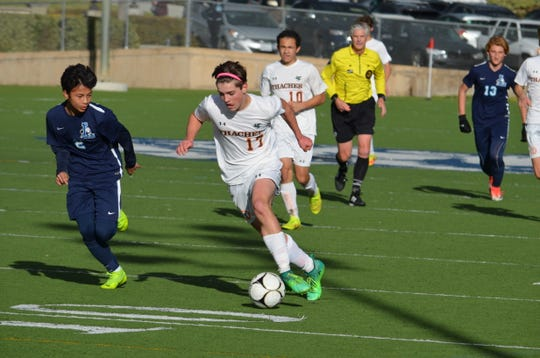 Thacher sophomore Peter Phipps dribbles the ball into the penalty area against host Linfield Christian in the CIF-Southern Section Division 7 semifinals.