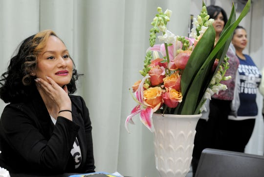 Carmen Perez, nationally known activist and Oxnard native, gets some flowers after speaking Wednesday at a Black History Month event at Oxnard College. Perez is best known as being one of the co-chairs of the national Women's March movement.