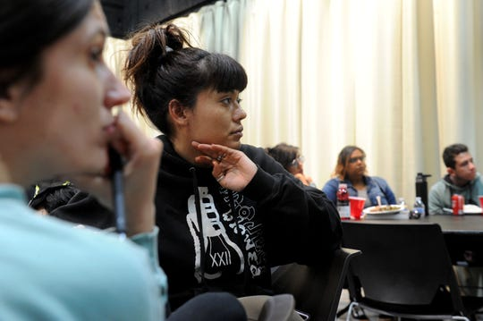 Julia Carroll, left, and friend Mary Arreguine listen to Carmen Perez, nationally known activist and Oxnard native speak Wednesday at Black History Month event at Oxnard College. Perez is best known as being one of the co-chairs of the national Women's March movement.