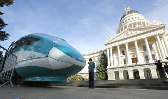 In this Feb. 26, 2015, file photo, a full-scale mock-up of a high-speed train is displayed at the Capitol in Sacramento.