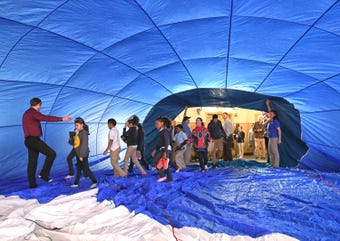 Balloon Talk Director Kelly Dubé and members of the REMAX Hot Air Balloon Team of New Jersey speak to Millville Public Charter School students during a demonstration on Thursday, Feb. 21, 2019.