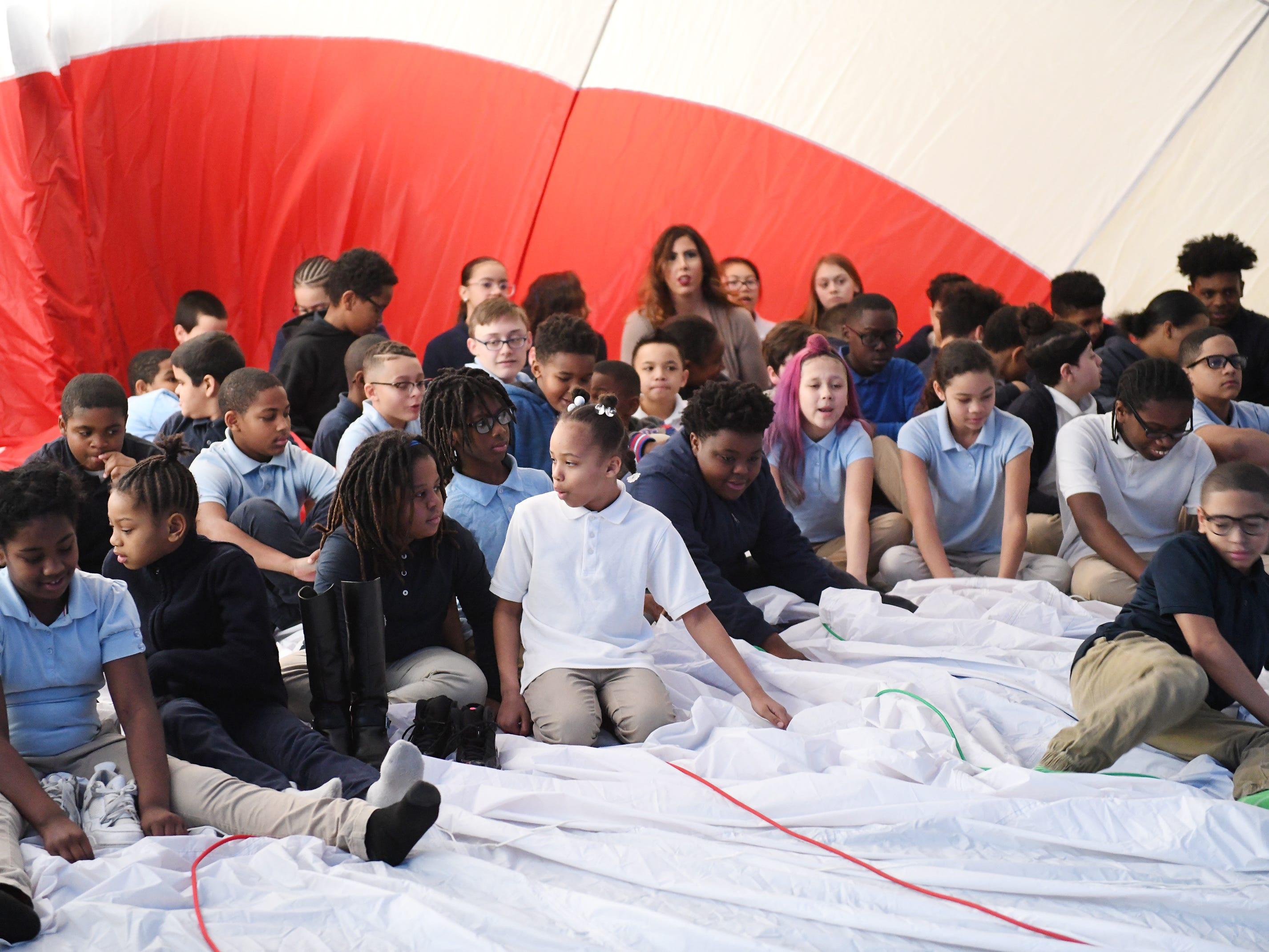 Members of the REMAX Hot Air Balloon Team of New Jersey put on a demonstration inside the Millville Public Charter School on Thursday, Feb. 21, 2019. Students experienced the inside of a filled balloon during the presentation.