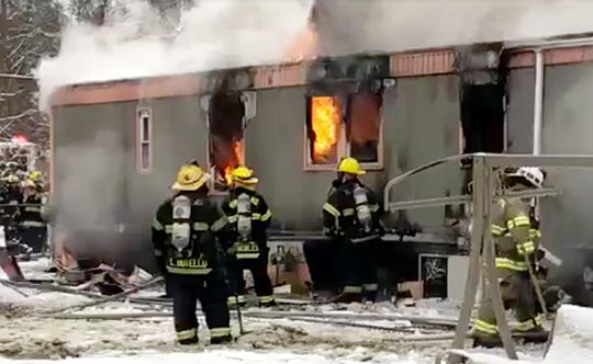 A fire raced through a Cedarcrest Village mobile home on Wednesday.