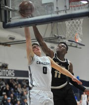 Central Valley Christian's Campbell Moons gets his layup rejected against Foothill Elihjah Seales during a Central Section Division IV high school semifinal playoff game at CVC on Feb 20, 2019.
