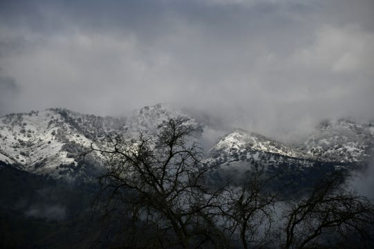 Snow-capped mountains can be seen from Highway 198 in Three Rivers on Thursday, February 21, 2019.