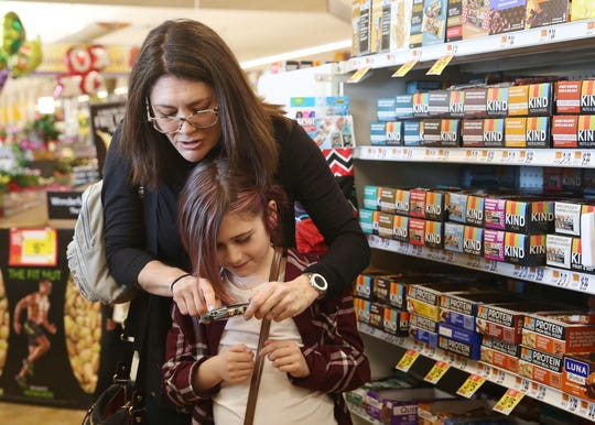 From left, Alison Hoffman helps her daughter Rebecca Peeples read the ingredients in a protein bar while at the Stop & Shop in North White Plains Feb. 21,  2019. Rebecca Peeples suffers from Type 1 Diabetes.