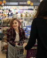 Rebecca Peeples rides on the front of her mom's shopping cart as they shop at the Stop & Shop in North White Plains Feb. 21,  2019. Rebecca Peeples suffers from Type 1 Diabetes.