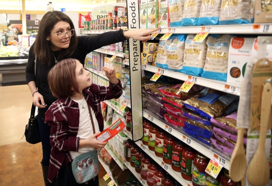 From left, Alison Hoffman helps her daughter Rebecca Peeples pick out items  while at the Stop & Shop in North White Plains Feb. 21,  2019. Rebecca Peeples suffers from Type 1 Diabetes.