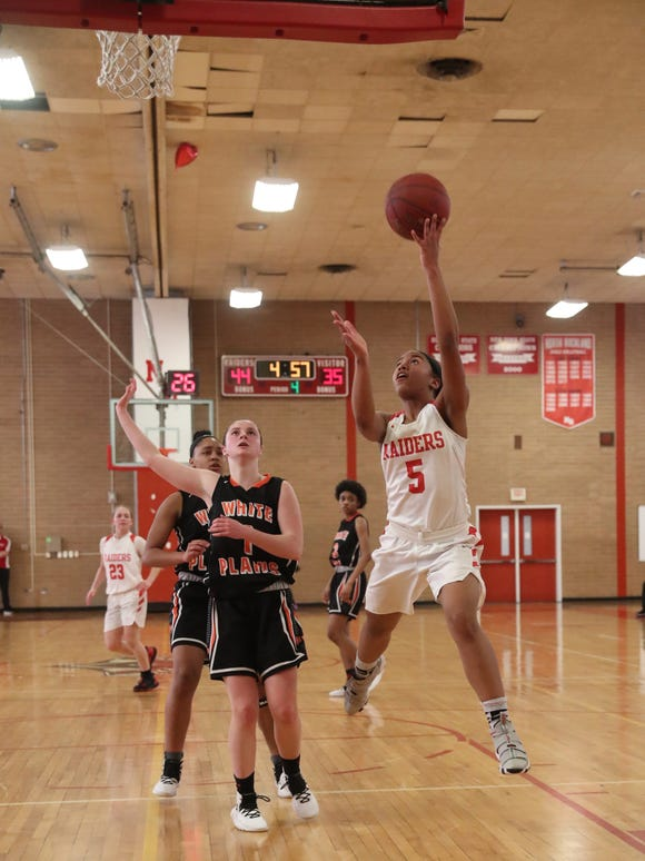 North Rockland's Olivia Levy (5) puts up a shot during their 49-38 win over White Plains in the class AA girls basketball playoff game at North Rockland High School in Thiells on Thursday, February 21, 2019.