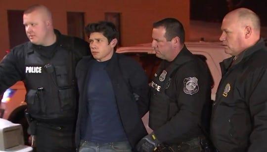 Jason Mendez, 35, of Washingtonville, New York, is shown here in police custody.