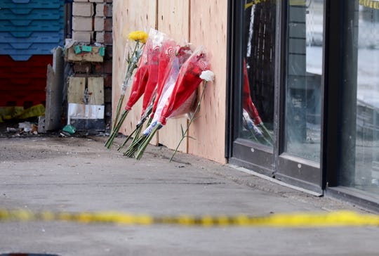 Memorial flowers are propped against the plywood covering the broken window, at The 7-Eleven on Central Highway in Haverstraw, Feb. 21, 2019.