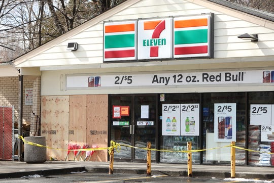 Memorial flowers are propped against the plywood covering the broken window, at 7-Eleven on Central Highway in Haverstraw, Feb. 21, 2019, the day after a man plowed his car into a family of eight then put his car into reverse and drove forward into them again, killing a 32-year-old mother of six.