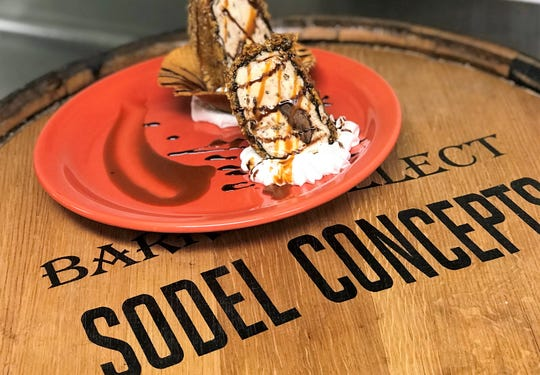 Papa Grande's Coastal Taqueria created a Samoas Fried Ice Cream with Caramel and Coconut covered with Oreo Crumb, Dulce De Leche, Panko and Shredded Coconut in a Waffle Bowl with Fresh Whipped Cream and Chocolate Caramel Sauce.