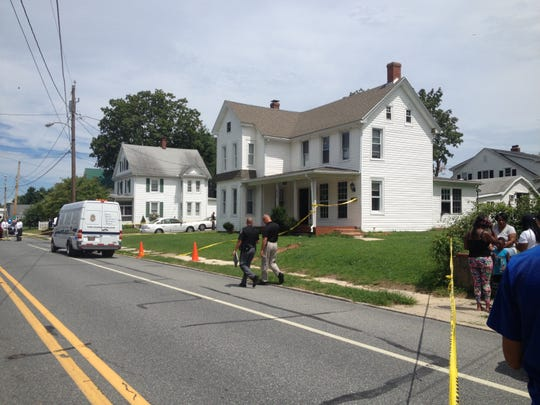 Milford Police investigate a 2015 home invasion in the 500 block of N. Walnut Street on Aug. 8, 2015.