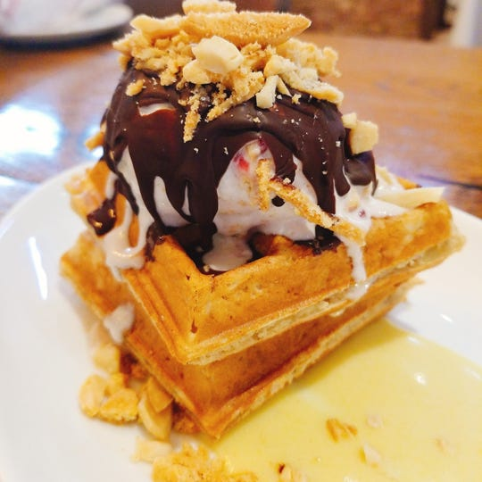 Bluecoast Seafood Grill + Raw Bar's Do-si-dos Banana-Waffle Cookie with Peanut Butter-and-Jelly-Crunch Ice Cream, Dark Chocolate Magic Shell and Banana Anglaise.