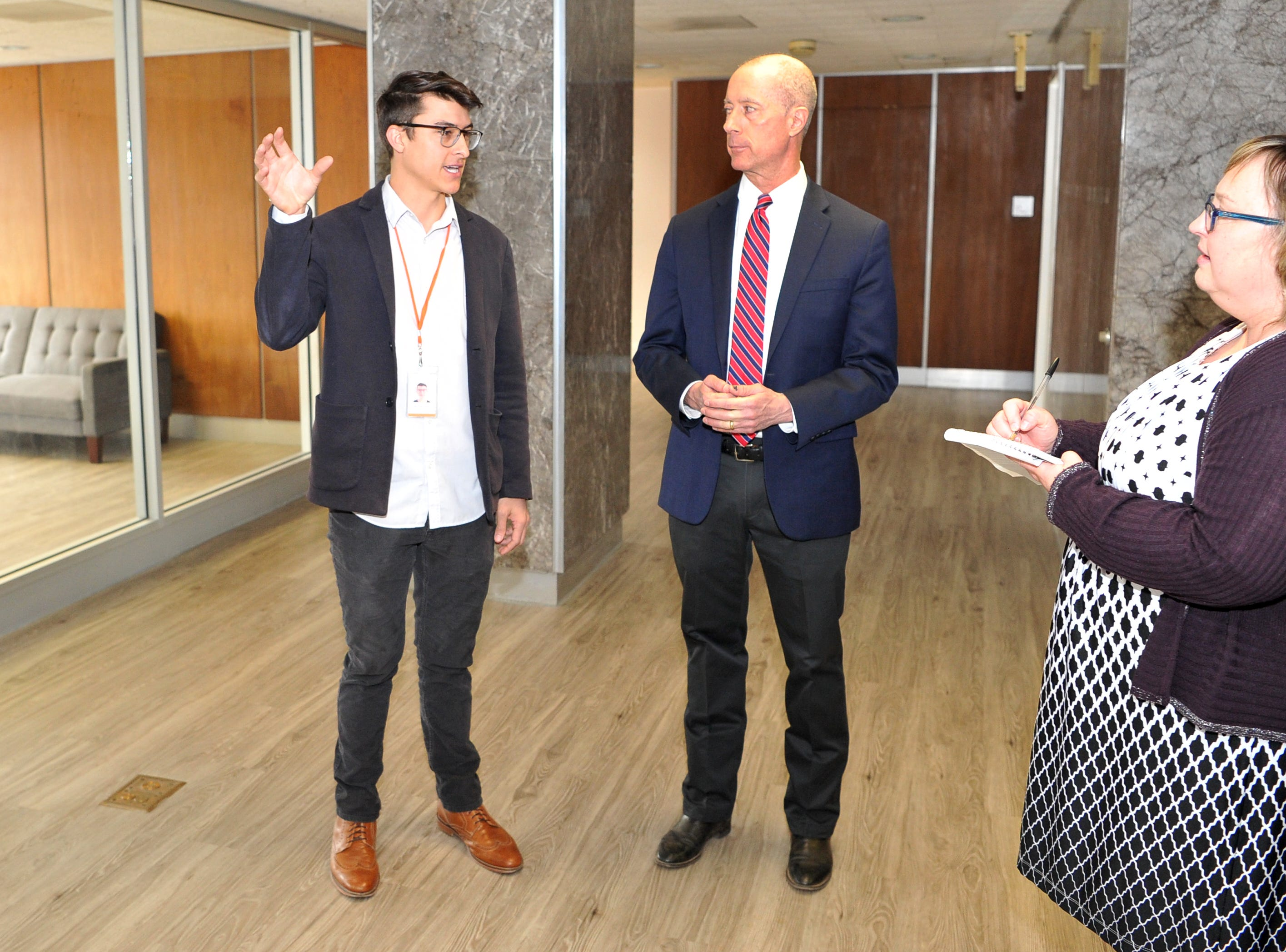 Michael Olaya, owner/CEO Dexter Learning, left, and 13th District, U.S Congressman, Mac Thornberry tour Olaya's learning center, Thursday morning.