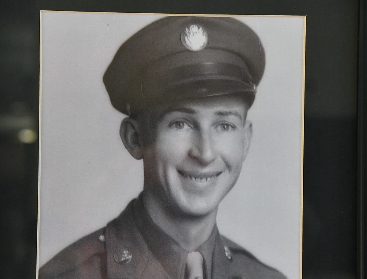 A framed portrait of a young Joe Cuba hangs on a wall at Brookdale Senior Living that honors veterans. Cuba was a SSgt. in the U.S. Army Air Corps in World War II and will turn 100 on March 2.